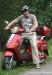 sisilisko-electric-vehicles-oy-sahkoskootterit-vaari-ja-metallin-punainen-sisilisko-sharp-sahkoskootteri